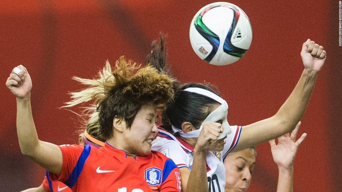 Costa Rica's Wendy Acosta, right, challenges South Korea's Ji Soyun during their 2-2 tie June 13 in Montreal.
