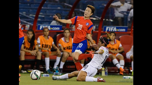Shirley Cruz of Costa Rica, right, challenges Kim Hyeri of South Korea.
