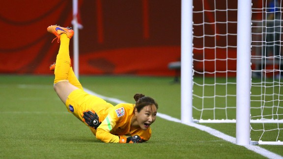 South Korean goalkeeper Kim Jungmi dives as a shot by Costa Rica goes wide of the goal.