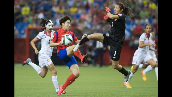 Costa Rica goalkeeper Dinnia Diaz comes out to knock the ball away from South Korea