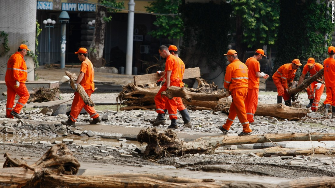 Municipal workers clean an area around the zoo on June 14.