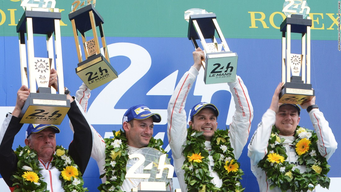 Porsche's development director Wolfgang Hatz celebrates with winning drivers Nick Tandy, Earl Bamber and Nico Hulkenberg, after the 83rd Le Mans 24 Hours endurance race.