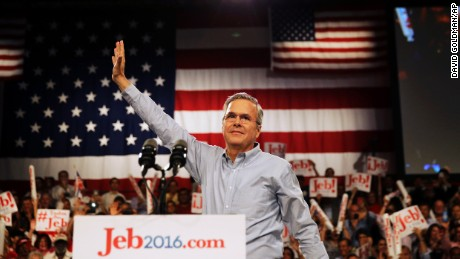 Former Florida Gov. Jeb Bush waves as he takes the stage as he formally announced he is joining the race for president with a speech, Monday, June 15, 2015, at Miami Dade College in Miami. (AP Photo/David Goldman)