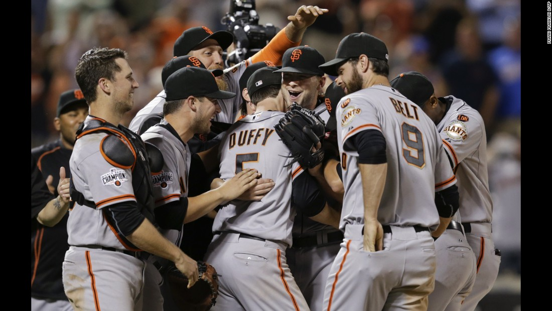 Chris Heston, facing the camera, is mobbed by his San Francisco Giants teammates after throwing a no-hitter Tuesday, June 9, in New York. The rookie right-hander struck out 11 Mets in what was only his 13th Major League start.