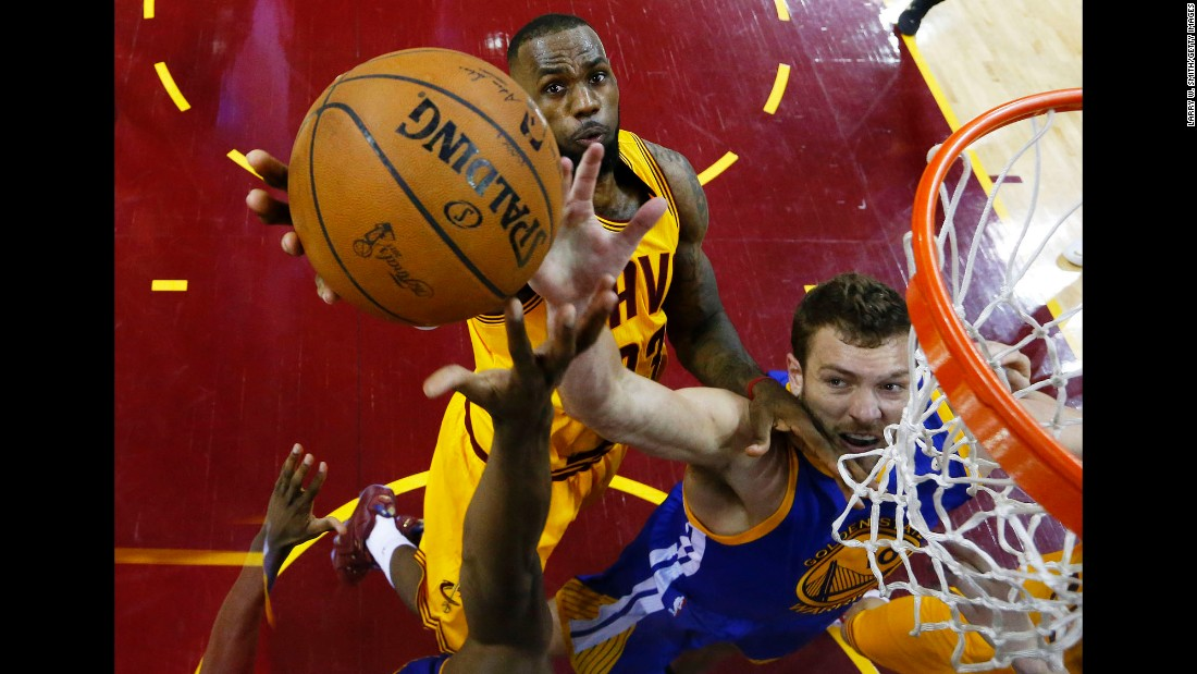 LeBron James, left, and David Lee reach for the ball during Game 4 of the NBA Finals on Thursday, June 11. Lee and the Golden State Warriors defeated James' Cleveland Cavaliers 103-82 to even the best-of-seven series at two games apiece.