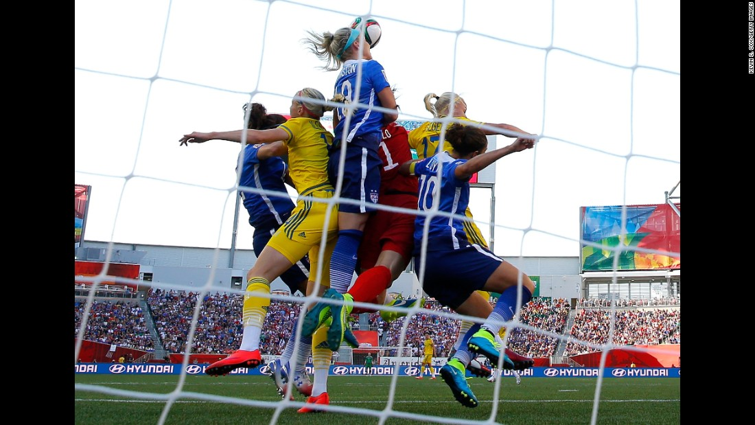 U.S. goalkeeper Hope Solo, in red, leaps for a save during a Women's World Cup match against Sweden on Friday, June 12. The match in Winnipeg, Manitoba, ended in a scoreless draw.