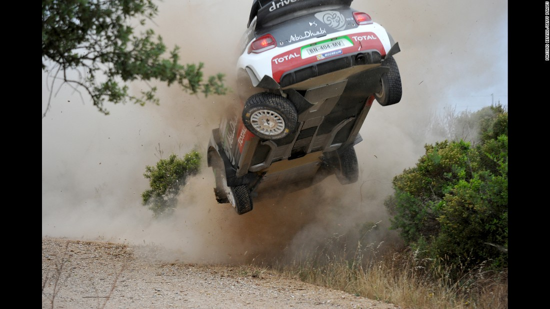 The Citroen of Kris Meeke crashes Friday, June 12, during the World Rally event in Alghero, Italy. Meeke went on to finish the stage after the car was repaired.