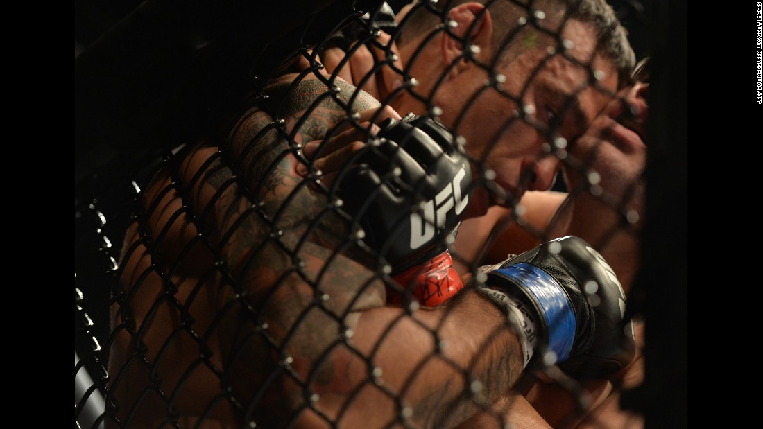 Fabricio Werdum is pushed against the cage by Cain Velasquez during their UFC heavyweight title bout on Saturday, June 13. Werdum won by third-round submission.