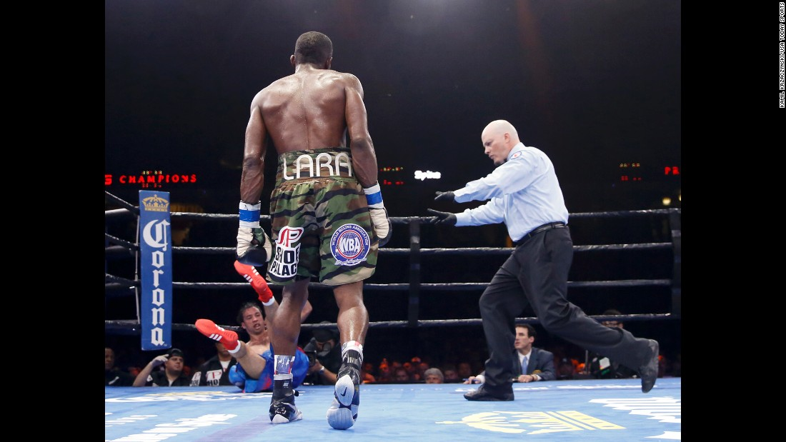 Delevin Rodriguez falls to the canvas after being knocked down by Erislandy Lara in Chicago on Friday, June 12. Lara won by unanimous decision to retain his WBA super-welterweight title.