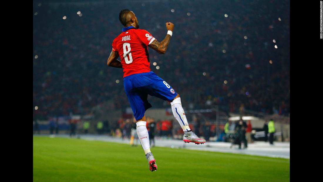 Chile's Arturo Vidal celebrates Thursday, June 11, after he scored a penalty against Ecuador in the opening match of the Copa America tournament. Chile, the tournament's host country, won 2-0 in Santiago.