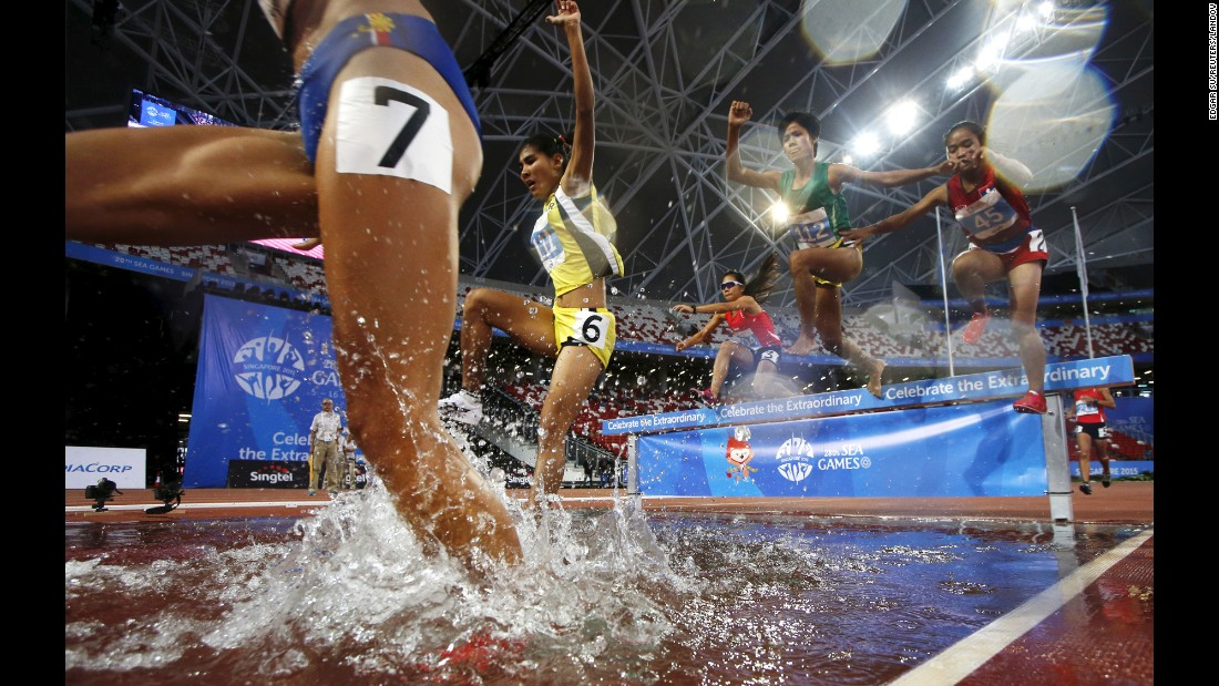 Competitors splash into the water pit during the final of the 3,000-meter steeplechase Friday, June 12, at the Southeast Asian Games.