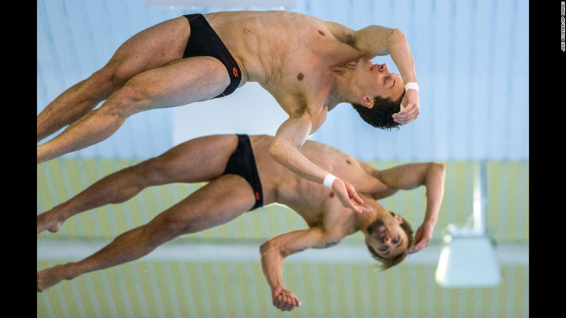 Germany's Patrick Hausding, front, and Sascha Klein perform a synchronized platform dive Sunday, June 14, at the European Diving Championships in Rostock, Germany. They won the event.