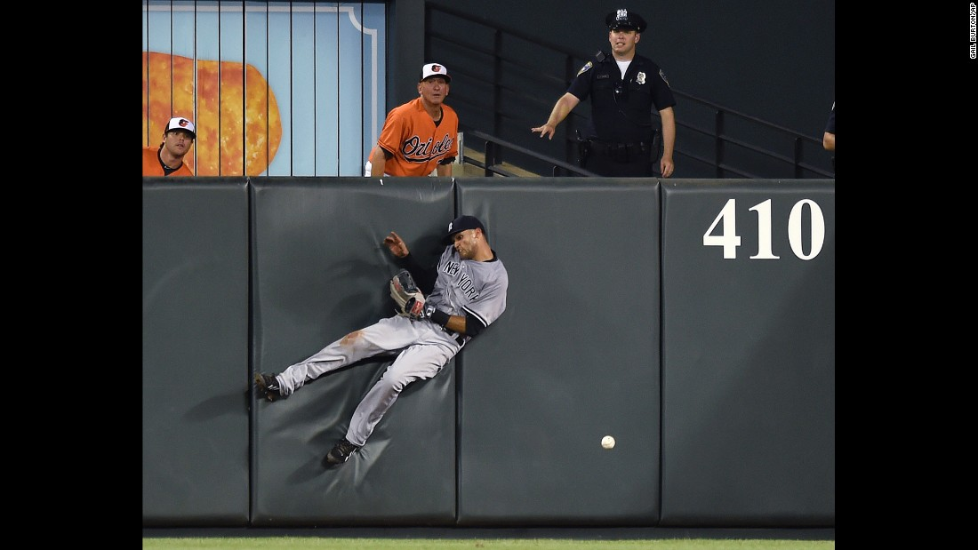 New York Yankees outfielder Mason Williams crashes into the wall as he tries to catch a fly ball in Baltimore on Saturday, June 13.