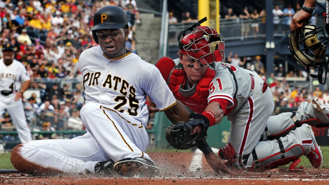 Pittsburgh's Gregory Polanco scores a run after the ball was knocked from the glove of Philadelphia's Carlos Ruiz on Saturday, June 13.