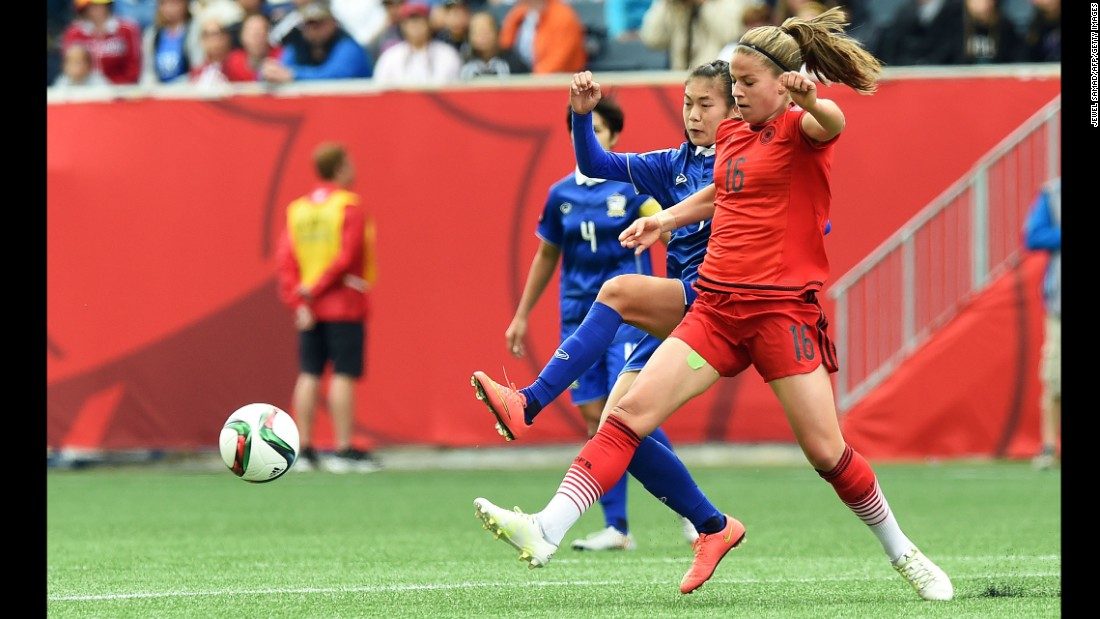 Germany midfielder Melanie Leupolz, right, and Thailand midfielder Silawan Intamee vie for the ball during a match June 15 in Winnipeg. Germany won 4-0.