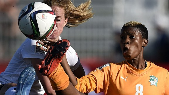 Norway midfielder Ingrid Schjelderup, left, competes for the ball with Ivory Coast forward Ines Nhrehy.