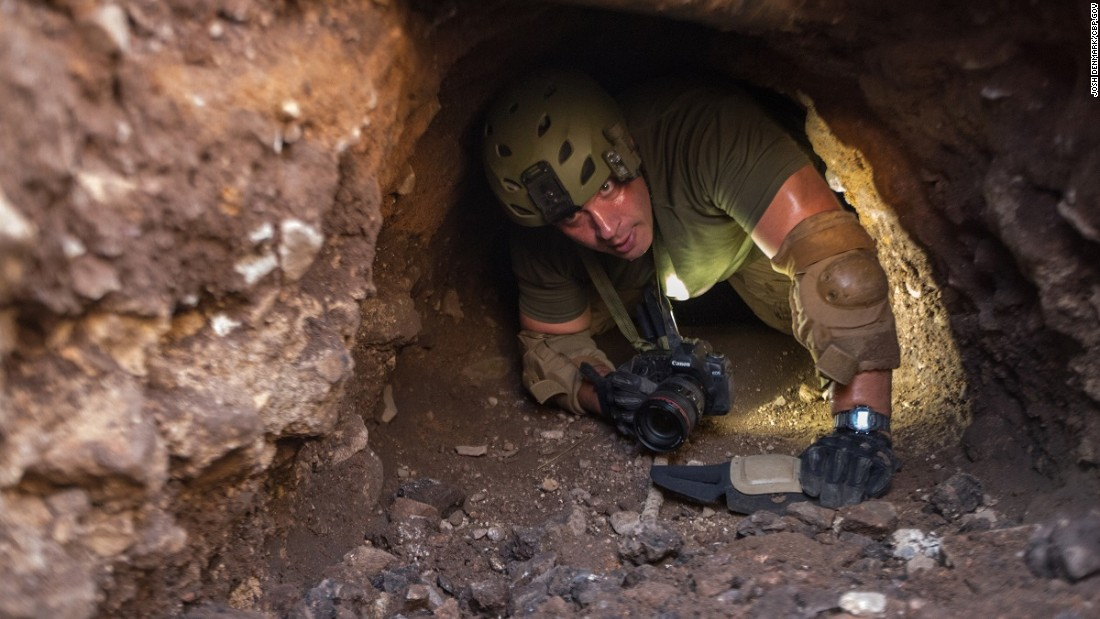 A border patrol agent inspects a tunnel near Nogales, Arizona. Tunnels like this are used to transport drugs under the U.S. border.