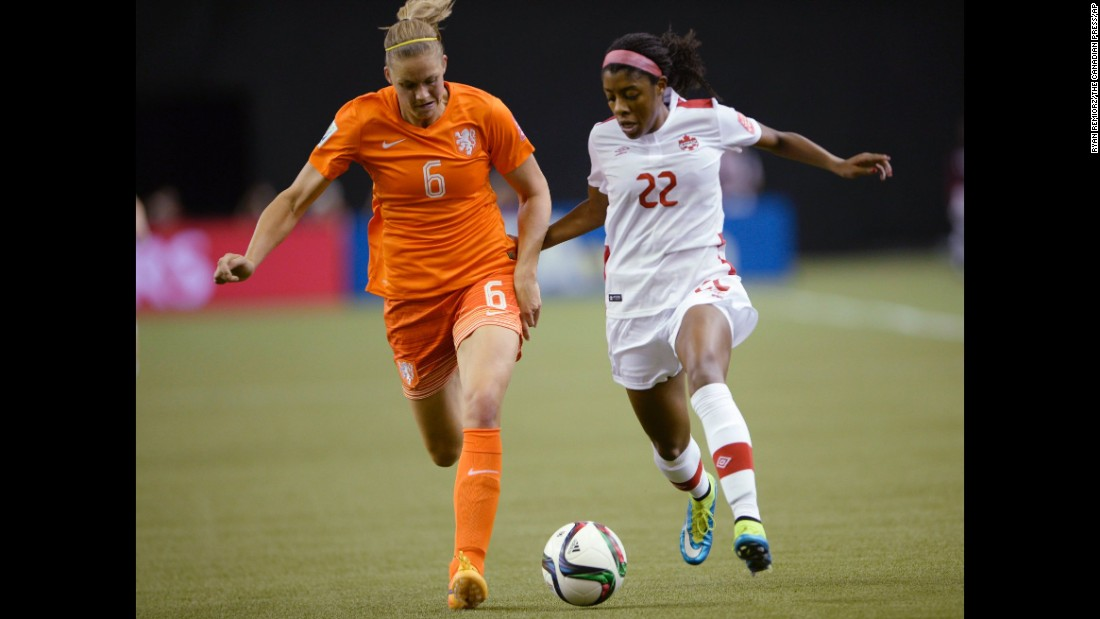 The Netherlands' Anouk Dekker, left, and Canada's Ashley Lawrence chase the ball during the first half of a match June 15 in Montreal. The two teams tied 1-1.