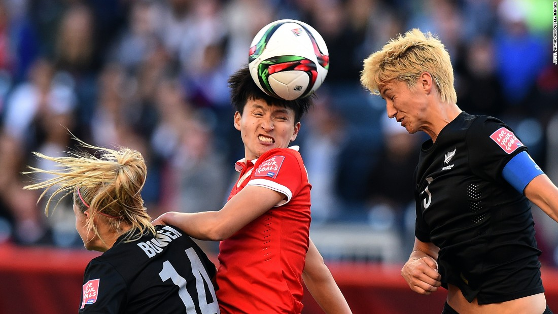 Chinese defender Wang Shanshan, center, heads the ball between two New Zealand defenders during a match in Winnipeg, Manitoba, on Monday, June 15. The match ended 2-2.