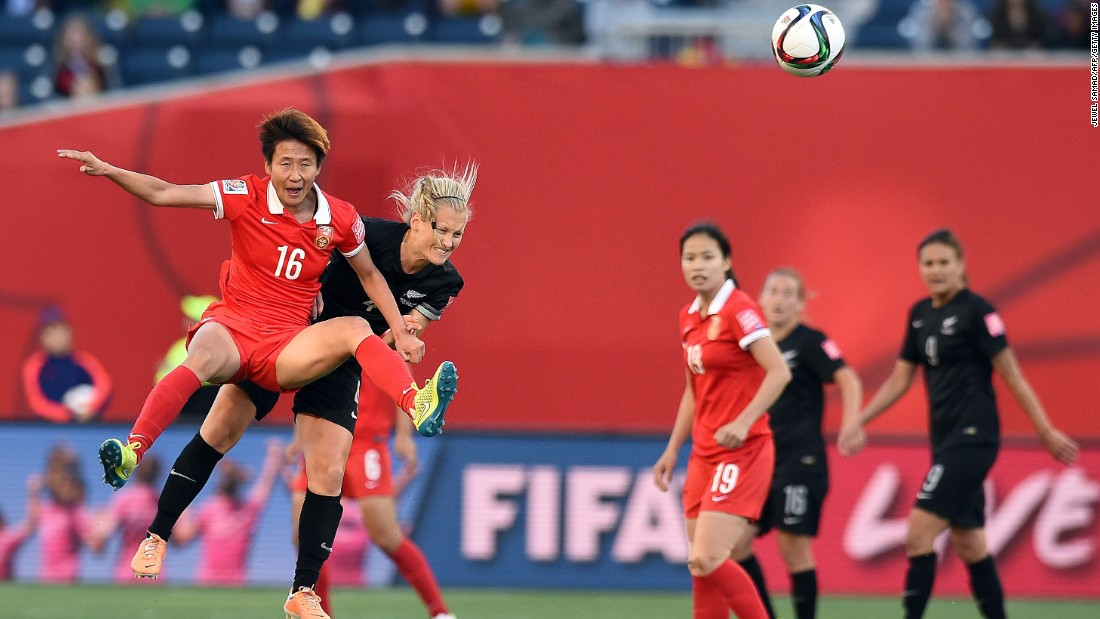New Zealand midfielder Katie Duncan, second from left, collides with China forward Lou Jiahui.