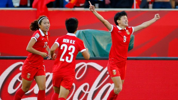 Wang, right, celebrates after scoring China