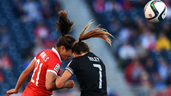 China midfielder Wang Lisi, left, and New Zealand defender Ali Riley vie for the ball.