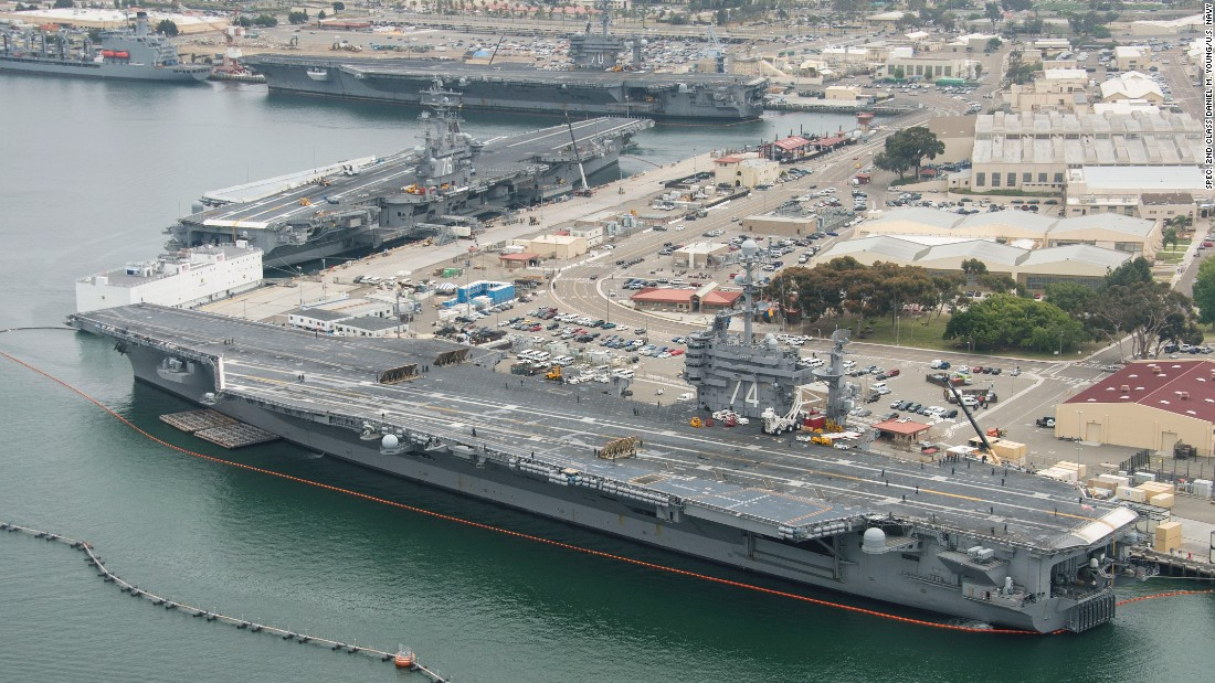 Three Nimitz-class aircraft carriers USS Carl Vinson (CVN 70), top, USS Ronald Reagan (CVN 76), center, and USS John C. Stennis (CVN 74) are pierside at Naval Air Station North Island near San Diego on June 12, 2015. The Vinson has just recently returned from a 10-month deployment. The Reagan is preparing for a move to Japan later this year and the Stennis was making a port call after steaming from its homeport of Bremerton, Washington.