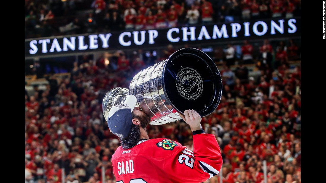 Brandon Saad of the Chicago Blackhawks celebrates with the Stanley Cup on Monday, June 15, after Chicago defeated the Tampa Bay Lightning to win their third championship in the last six years.