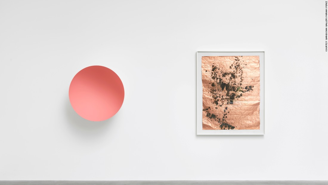 Anish Kapoor produced this piece on fiber glass (left) especially for the exhibition. It sits alongside Andy Warhol's urinated 'spray' onto acidic paint on a sheet of metal.
