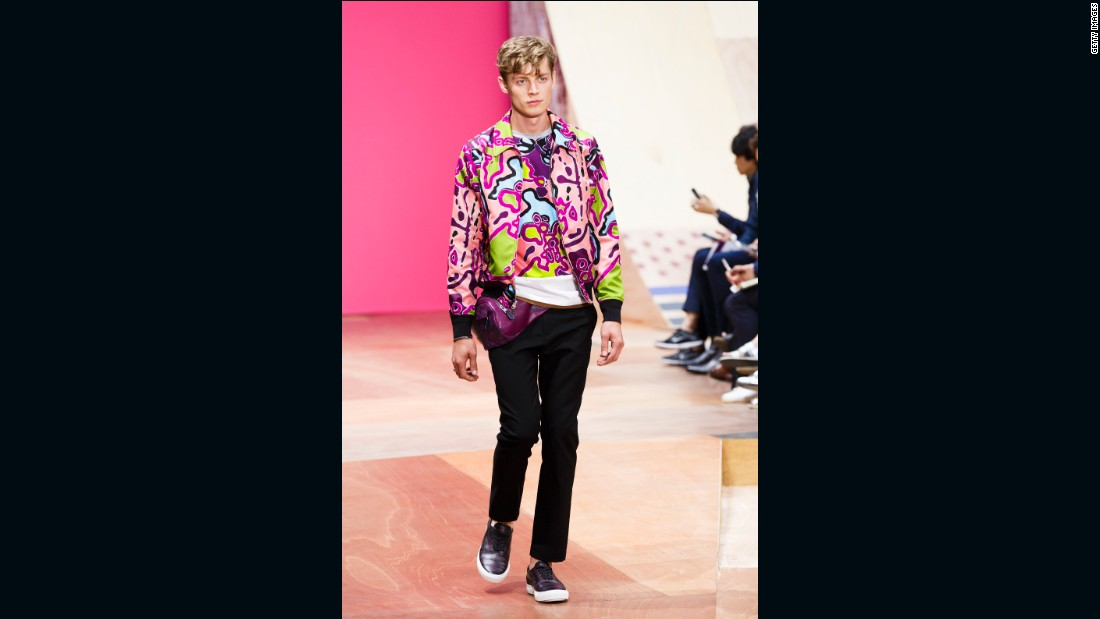 "For Coach's first-ever runway show, designer Stuart Vevers dismantled the idea that the American label only does leather goods. He has described the collection as ""Kennedy boys meet Beach Boys meet Beastie Boys,"" and that comes through in the neon coloring and kitsch fanny packs."