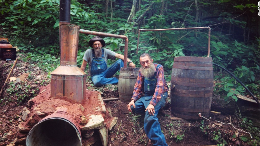 "Marvin ""Popcorn"" Sutton (right) - one of the legends of bootlegged moonshine, with his largest ever still. But the industry is entering a new, legitimate era."