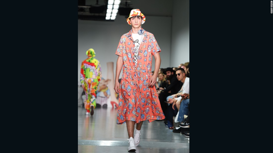 Known for quirky prints and motifs, Kit Neale threw every color imaginable onto the runway across bomber jackets, boiler suits, shorts, parachute pants and this floral print smock dress. For men.