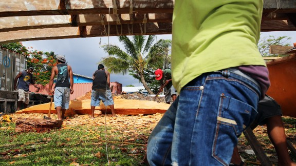 """Marshallese people are known as master canoe builders and navigators. Including the ocean, the nation is three times the size of Texas. But it only has as much land as Washington, D.C. """"We are not a small island country,"""" said Tony de Brum, the foreign minister. """"We are a big ocean country."""""""