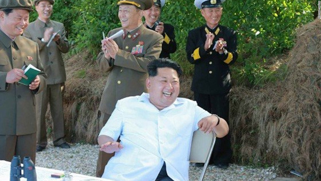 Kim beams while reportedly watching a rocket testing in North Korea, in this picture published in Rodong Sinmun.