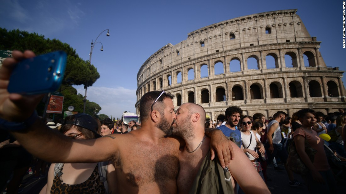 Two men kiss in front of the Colosseum during a gay pride parade in Rome on Saturday, June 13.