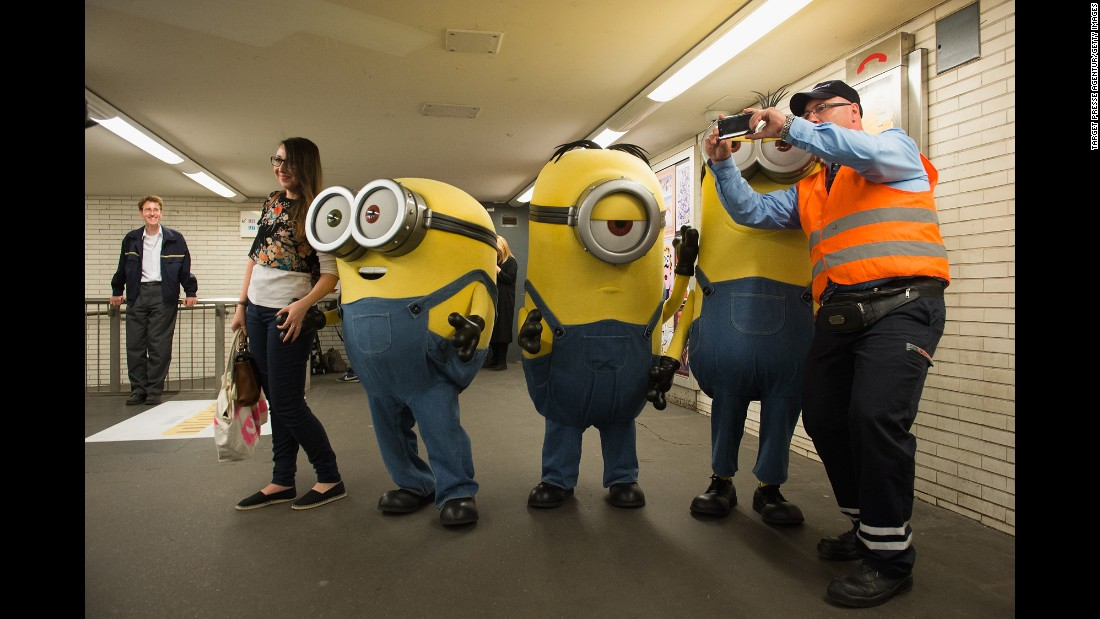 "Three mascots from the animated film ""Minions"" take photos in Berlin on Tuesday, June 16."