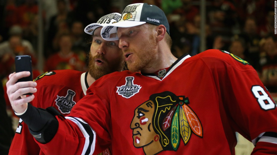 Two stars of the Chicago Blackhawks hockey team -- Duncan Keith, left, and Marian Hossa -- take a selfie after the Blackhawks won the Stanley Cup on Monday, June 15. Keith won the Conn Smythe Trophy for being the playoffs' most valuable player.