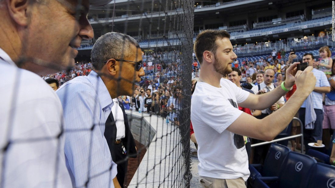 "U.S. President Barack Obama interacts with fans Thursday, June 11, at the <a href=""http://www.congressionalbaseball.org"" target=""_blank"">Congressional Baseball Game</a> in Washington. The annual event raises money for charity."