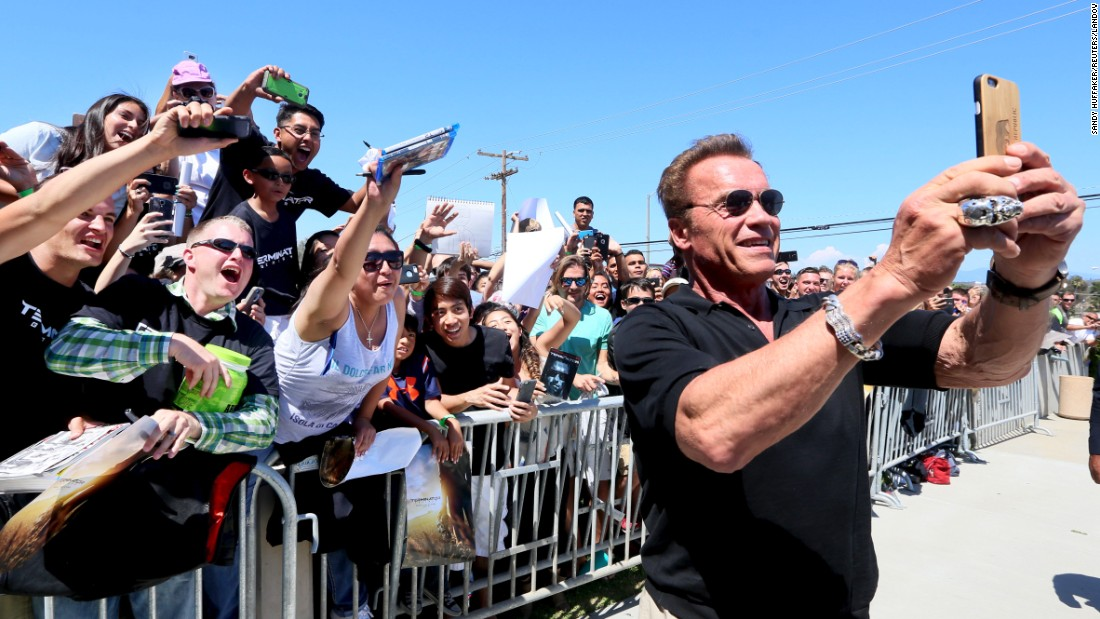 "Actor Arnold Schwarzenegger, former governor of California, takes a selfie at a screening of his new film ""Terminator Genisys"" on Sunday, June 14. The screening was held at Camp Pendleton, a Marine Corps base in San Diego County."
