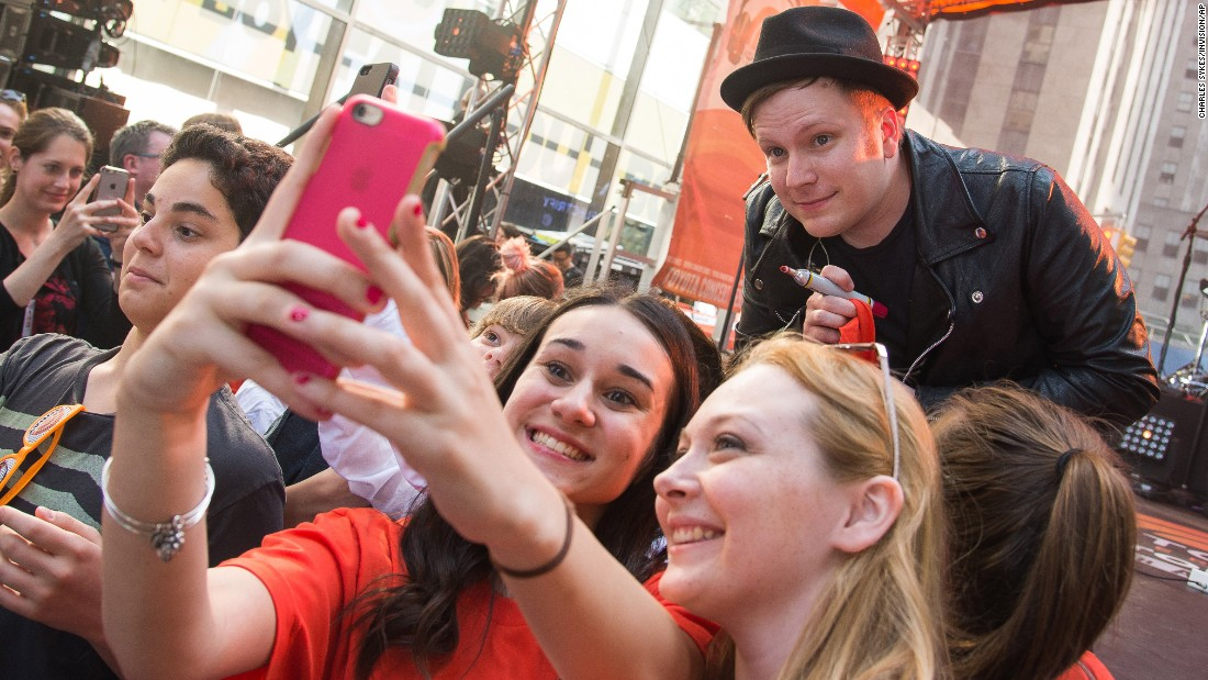 "Fall Out Boy lead singer Patrick Stump poses for a fan's selfie in New York on Friday, June 12. The band was performing for NBC's ""Today"" show."