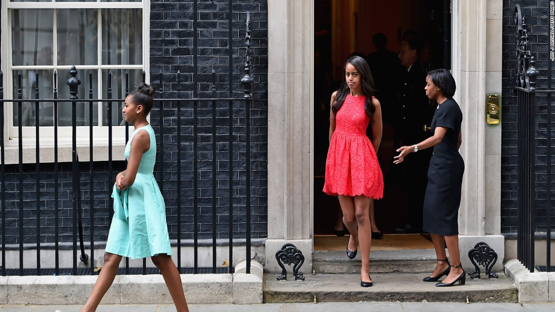 Sasha Obama, left, and Malia Obama, center, leave Downing Street after a meeting with the Prime Minister and his wife on June 16.
