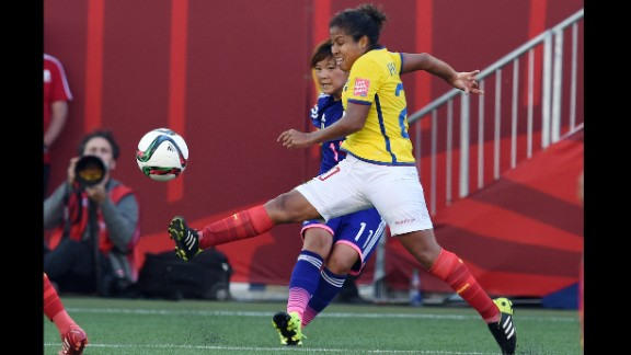 Japan forward Shinobu Ohno and Ecuador forward Denise Pesantes compete for the ball.