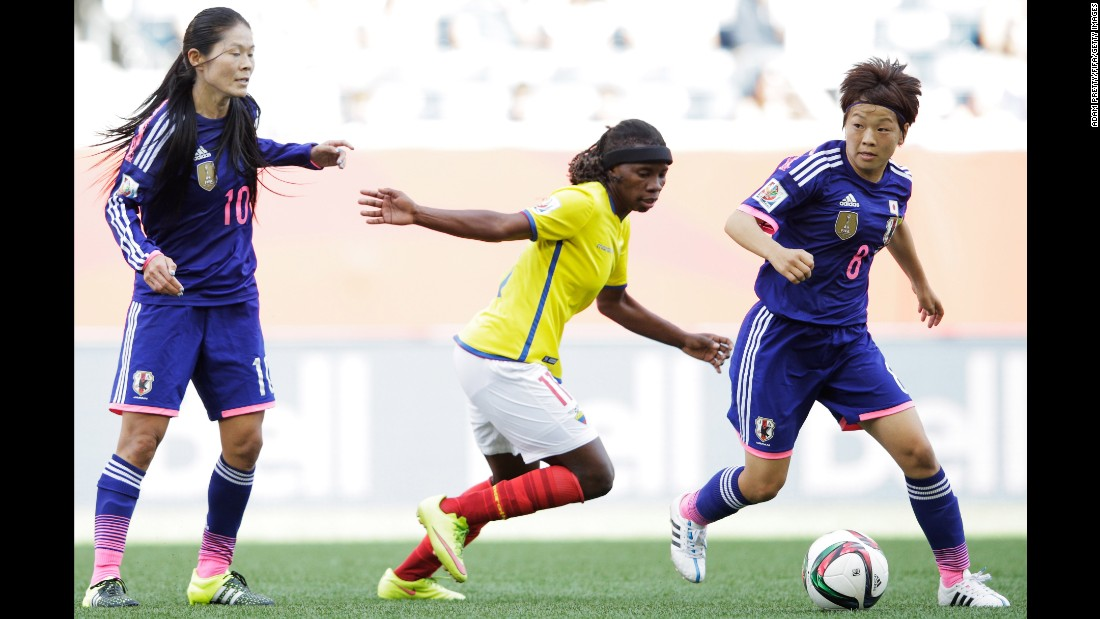 Aya Miyama of Japan is tracked by Monica Quinteros of Ecuador.