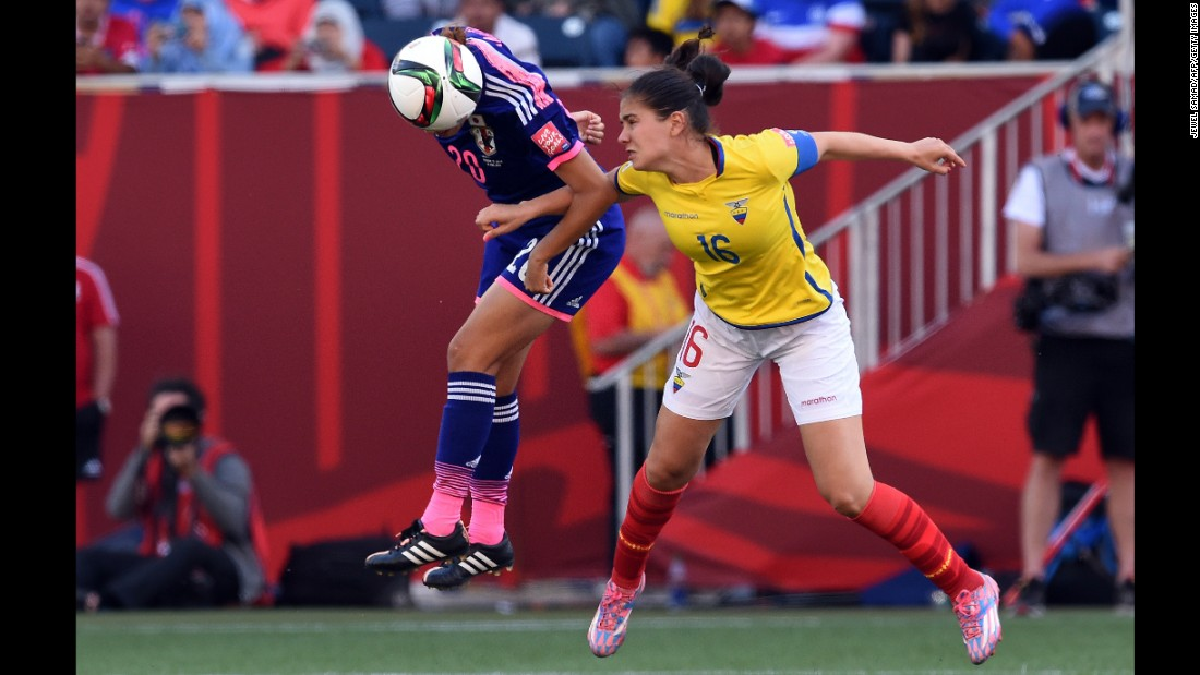 Japan defender Yuri Kawamura, left, and Ecuador defender Ligia Moreira go for the ball.