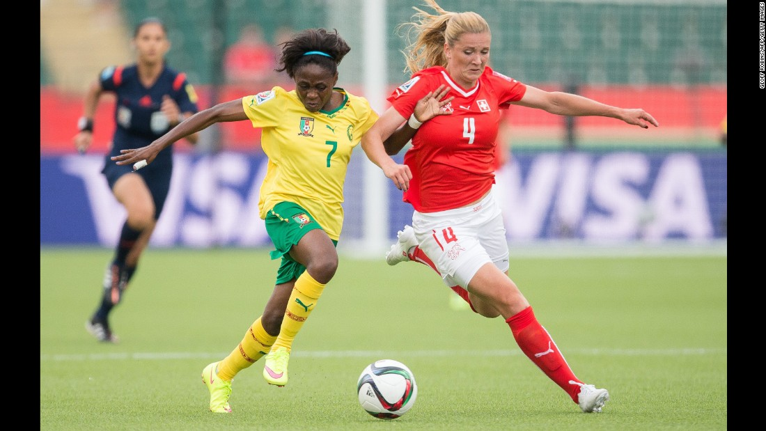 Cameroon's Gabrielle Onguene, left, and Switzerland's Rachel Rinast compete for the ball during a Women's World Cup match in Edmonton on June 16. Cameroon won the match 2-1.