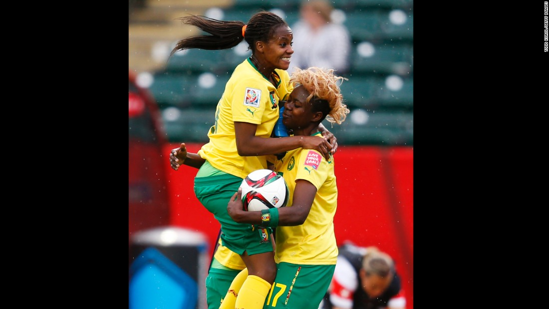 Cameroon's Aurelle Awona, left, celebrates with teammate Gaelle Enganamouit.