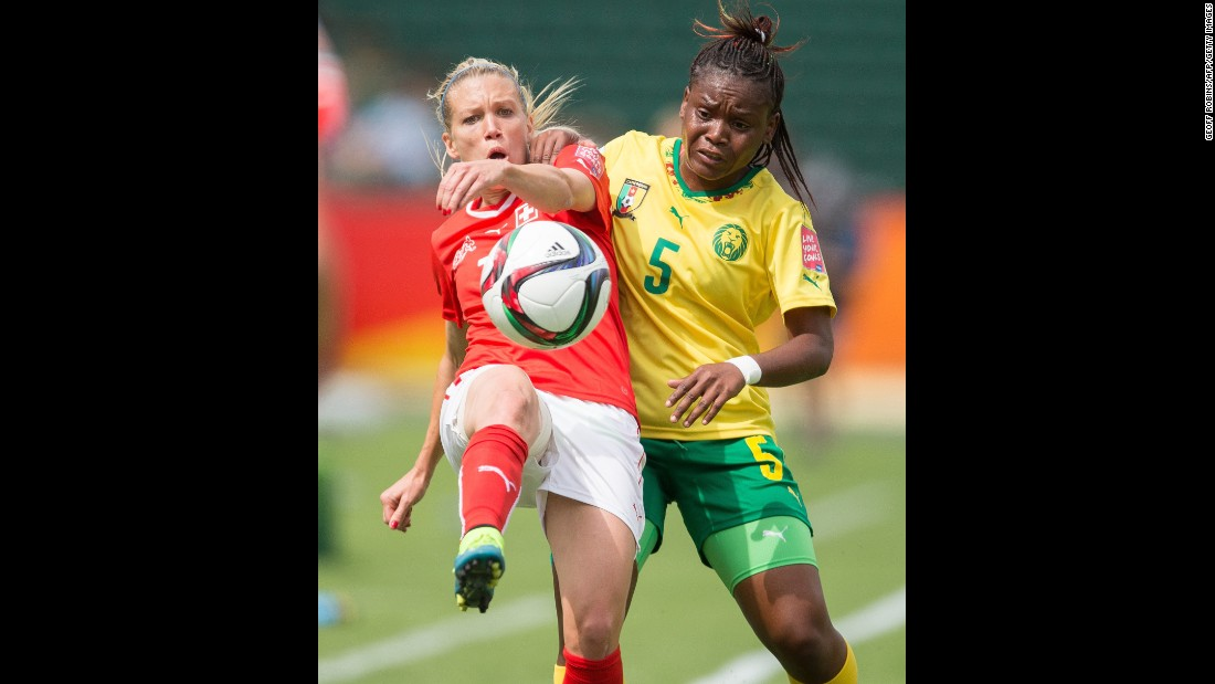 Switzerland's Lara Dickenmann and Cameroon's Augustine Ejangue jostle for the ball.