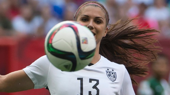 Morgan, making her first start of the tournament, keeps her eye on the ball against Nigeria.