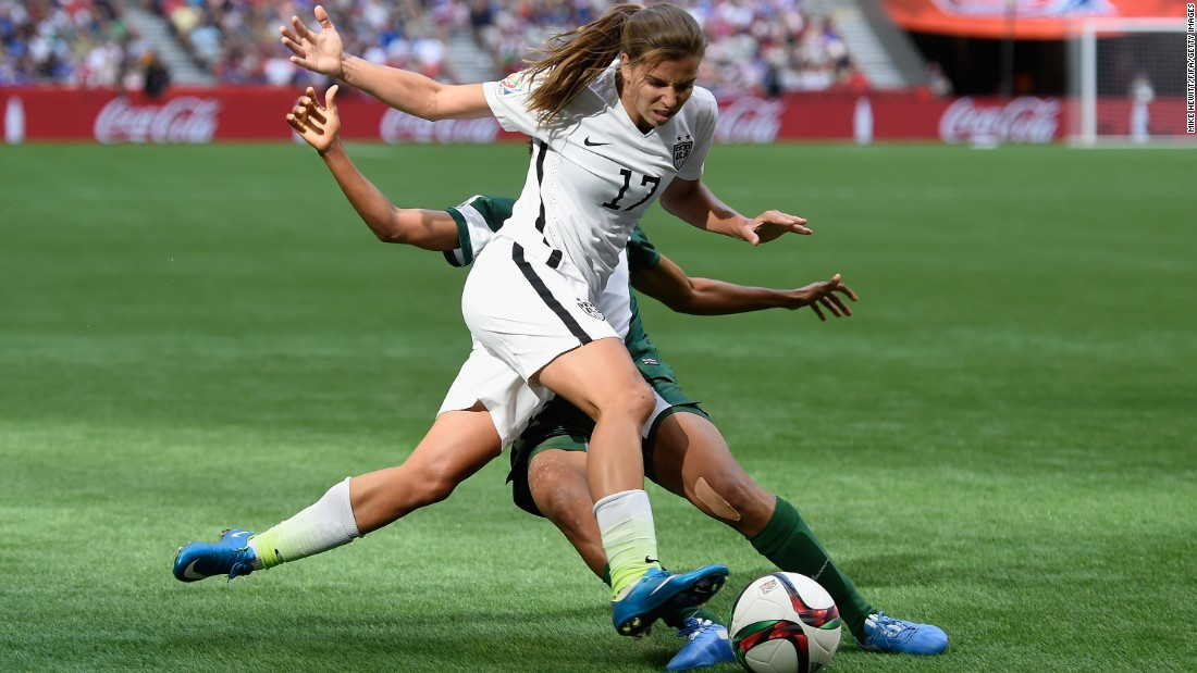 Heath is tackled by Nigeria's Esther Sunday.
