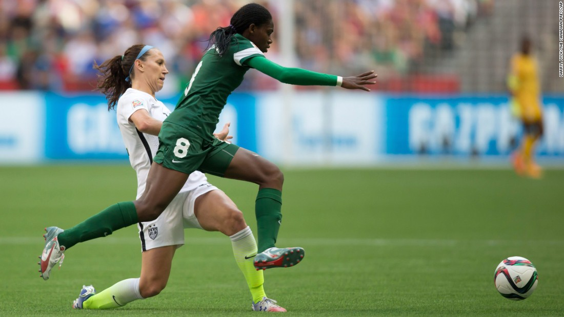 Nigeria's Asisat Oshoala leaps past Lauren Holiday as she chases the ball.